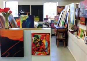 Looking into my studio space, black canvases on back wall:  works in progress, February 2015.