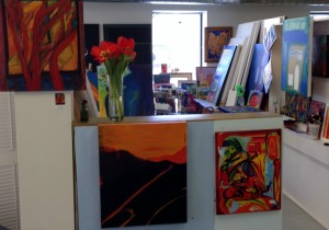 Looking into my studio space, fresh orange tulips grace the showcase shelf, beaming happy working hours,   February 2015.